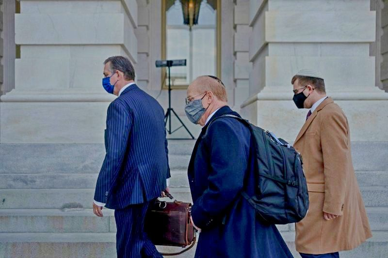 Attorneys for former President Donald Trump, Bruce Castor and David Schoen arrive prior to the start of the impeachment trial at the Capitol in Washington, on Feb. 10, 2021.