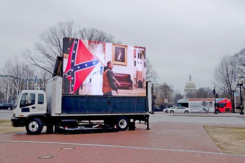A truck operated by the SuperPAC Meidas Touch shows scenes from the insurrection outside Union Station during the impeachment trial of former president Donald Trump in Washington, on Feb. 10, 2021.