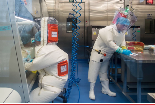 Scientists work inside the P4 laboratory in Wuhan.